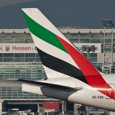 Tail fin of Emirates Airline Boeing 777-31H (ER) A6-EBK which is taxiing