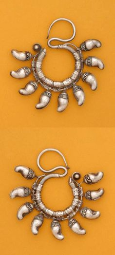 Southwest China | Earrings from the Miao or Dong people. || ©Truus Daalder, *Ethnic Jewellery and Adornment*, p. 264. Posted by Joost on their FB page.