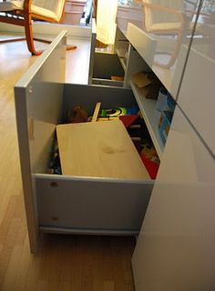 """Elena and Markus are total Ikea addicts who hacked this Besta storage for toys. """"We bought two Besta shelf units last spring and wanted to use them to store the kids' toys in the living room. Unfortunately you cannot have this unit with two drawers, because the drawers are a little less than half the [&hellip"""