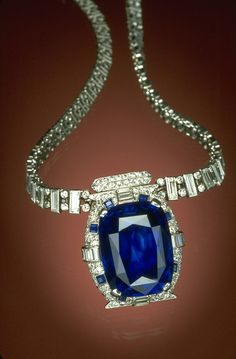 THE SMITHSONIAN NATIONAL MUSEUM OF NATURAL HISTORY, WASHINGTON, D.C. - Countess Mona von Bismarck donated this 98.57 Burmese sapphire to the Smithsonian in 1967. It is mounted on an Art Deco necklace designed by Cartier and displayed in the museum with countless priceless gems, including the Hope Diamond.