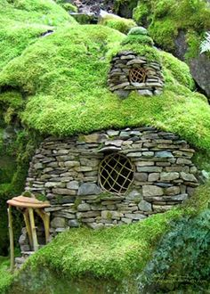 This Emerald Moss Faerie House appears to have grown in place!  Greenspirit Arts. Reminds me of a hobbit hole