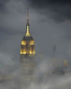 Classic shot of the Empire State Building with the WTC One emerging from the foggy background Credit: Charles Schnyder