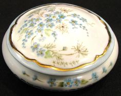 An old French Limoges trinket box with forget-me-nots
