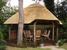 Lapa furniture, go for wood other natural materials for that South African outdoorsey feel. This one is an example from Property News Gauteng. Thatched House, Thatched Roof, Village House Design, Village Houses, Round House Plans, Small Gazebo, Fish Pond Gardens, African House, Old Cottage