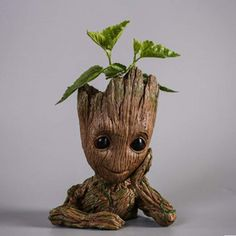 An adorable planter that looks like baby Groot in which you can put your favorite plant… or pencils! That's probably what I would use it for since I'm not very good at keeping potted plants alive. I am Groot! [Guardians of The Galaxy Baby Groot Planter] Baby Groot, Star Lord, Groot Action Figure, Grands Pots, Geek Decor, Pen Holders, Guardians Of The Galaxy, Potted Plants, Small Plants