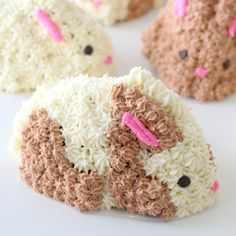 These cakes look like baby bunnies and taste like fresh strawberries – perfect for spring!. Ingredients:  Strawberry Cake batter, 2 cups unsalted butter, room temperature , 1 tsp vanilla extract , 5 cups confectioner's sugar , pink & brown food colouring , mini chocolate chips, 1 lb strawberries, stems removed and quartered , 2 tbsp sugar