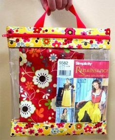 This is the perfect bag to keep your sewing projects neat and organized with all the individual bits and pieces stored inside. The bag has a handle for eas
