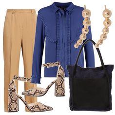 Anche in ufficio, mai rinunciare alla femminilità! Pantaloni dalla linea morbida color cammello abbinati a una camicia blu con piccole ruches - scarpe pitonate con tacco largo e cinturino alla caviglia, grande borsa blu notte e orecchini dorati.