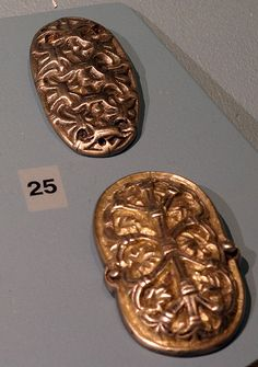 ENGLISH: Top: Buckle or broche from the Viking age, found in Fjaler, Western Norway. Exhibitied at Bergen museum.