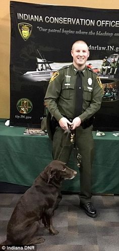 INDIANA... Adorable photos show K9 nuzzle with conservation officer | Daily Mail Online