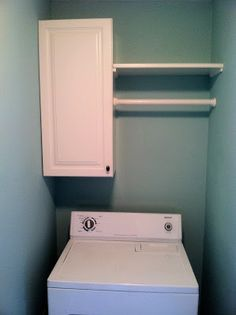 Laundry Room with cabinet and hanging space.