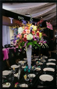Brightly colored flowers are perfect for Bat Mitzvah centerpieces. | MitzvahMarket.com
