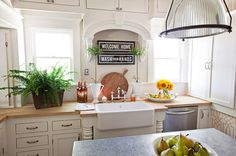 I love the kitchen sink.  Mostly I love the sign above the sink....I am a freak about washing your hands as soon as you get in the door.  Room Inspiration – Kristin Alber Style | The Lettered Cottage