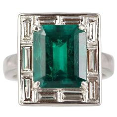 6.25 Carat Emerald Cut Emerald and Diamond  Platinum Ring | From a unique collection of vintage fashion rings at http://www.1stdibs.com/jewelry/rings/fashion-rings/