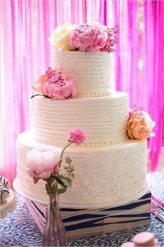 Beautiful white wedding cake with peonies
