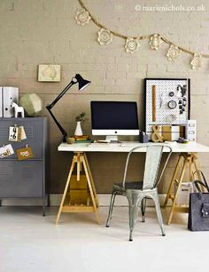 desk, lamp, chair, wall decor... uh!
