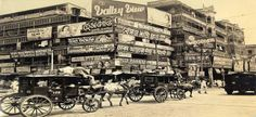 """Calcutta, """"A bewildering mass of billboards at the corner of Harrison Street (Burra Bazar) and Strand Road. One of the oldest sections of Calcutta, at the foot of Howrah Bridge. Rare Pictures, Rare Photos, Vintage Photographs, Old Photos, Vintage Photos, Jaisalmer, Udaipur, India West, City Road"""