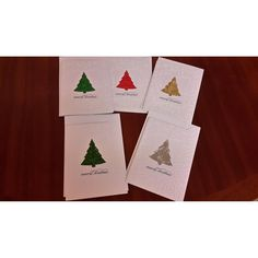 """This beautiful set of Handmade Christmas Greeting Card & gift cards features a Christmas Tree design, giving focus to the Christmas Tree arrangement.The set comprises an attractive sturdy Christmas box with 10 greeting size cards, 10 gift cards & includes silver/white pen. .All of the cards have envelopes & cellophane packaging.All of the standard C6 greeting cards includes a verse and has a greeting message on the front """"Merry Christmas"""".The larger ..."""