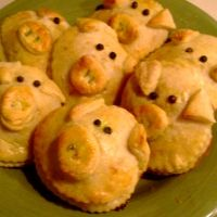 Adorable - Lil Piggy Biscuits Stuffed With Ham And Cheese.    Need:  1 container of Pillsbury Italian bread dough.;  ½ cup of chopped ham;  ½ cup cheddar cheese;  1 Teaspoon peppercorns;  1 teaspoon fresh rosemary;  1 egg