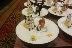 """Big Top Theme: This year's """"Give Kids the World"""" benefit took place at the Hyatt Regency Orlando in May and had an """"Under the Big Top"""" theme. For dessert, executive pastry chef Alain Vergnault put together a confection that combined caramel apple cake, cotton candy, and soft-serve-style vanilla crème fraîche."""