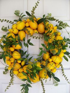 Lemon's bright, sunny hue is a perfect match for the summer season, and these lemon home accents infuse your interior design scheme with citrus. From coasters to wall art, there's plenty on offer for those who love lemon. Lemon Wreath: This su Wreath Crafts, Diy Wreath, Door Wreaths, Diy Crafts, Wreath Ideas, Wreaths For Front Door, Corona Floral, Lemon Wreath, Fresh Wreath