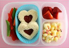 Sandwich, berries, peppers, popcorn (which is a whole grain- I don't even know what is in the picture)