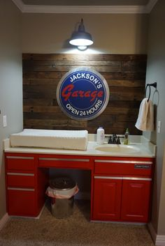 Vintage Garage Inspired Nursery - what a fun pallet wall and clean-up sink area!