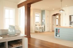 Fresh, modern and cozy! Bamboo floors, reclaimed wood columns and beams and a white kitchen with island colors from the sea. Pale turquoise