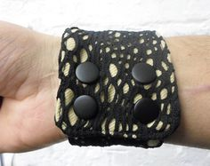 Industrial / post-apocalyptic / Sci Fi vegan-friendly desert sand bracelet with black spider mesh