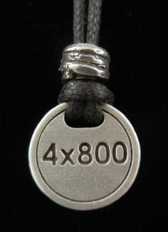 A pendant for Track and Field runners. This pewter pendant is for the 4 x 800 relay runners. That's ME!!!!