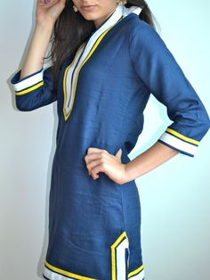 Say good-bye to the normal, beach tunic! The Guru Montauk Linen Tunic has a tailored cut to flatter every body type. And fit for every occasion! Guru's Linen Tunic is made of 100% European Linen, bought locally in NYC. Body of tunic is made of navy linen, and embellished with hand-stitched white and yellow piping. Piping detail is made of same fabric. Tunic Top option is 31 inches long with full sleeves. Tunic Dress option is 35 inches long with 3/4 sleeves. Shown in Tunic Dress style. ...