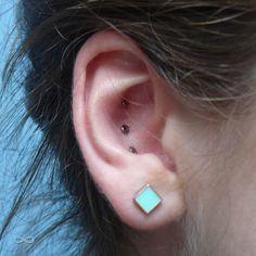 """infinitebody: """" Healed tripple Conch piercing with NeoMetal anodized bronze titanium discs, by Kali. """""""