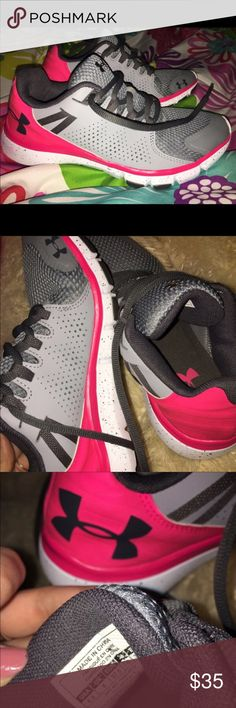 Under armor  eye catching shoes My loss is your gain purchased on posh and there to small for me. Beautiful almost Bran new pink and gray eye catching shoes. Under Armour Shoes Sneakers