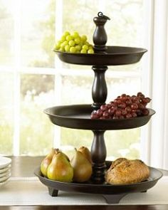 fill with colorful decorative balls and bottom layer with pinecones of various sizes - makes a beautiful table display