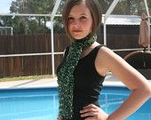 handknit green trellis scarf.knitted with ICE YARNS LADDER