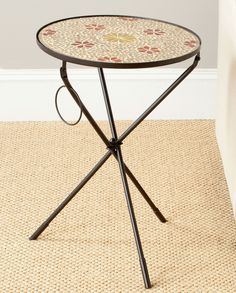 Cymbeline Side Table FOX3205A Description : Fun and functional, the Cymbeline side table by Safavieh is decorated with a glass mosaic top in a rust and gold floral motif. Graceful iron tripod legs ass