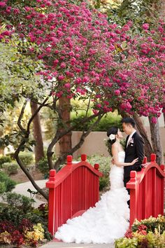 Beautiful mix of the traditional chinese red wedding colors and the traditional american wedding dress