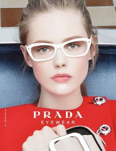 ca1ec673fd1 White glasses by Prada. See our Prada glasses at http   www.