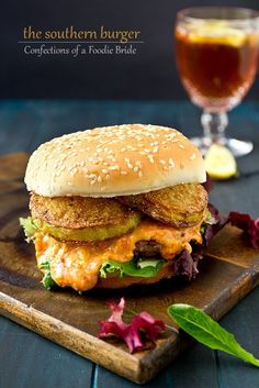 Pimento Cheese Southern Burger - It's a Southern favorite, beef burgers stuffed with pimento cheese and topped with fried green tomatoes.