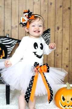 Be the cutest ghost in town with our halloween set!Included in this costume set is1 long or short sleeve onesie or shirt with a sparkly ghost applique1 Solid white tutu with double bows as shown1 pair of black and white polkadot legwarmersPerfect for not so scary halloween party, trick or treating, halloween pageants, birthday parties and more!Please see shop announcements for shipping time!