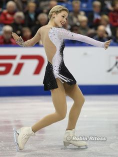 how lovely she is, but I would like to see more arch in the back at this point...Gracie Gold