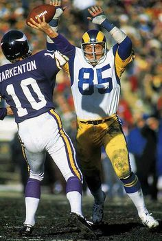 Los Angeles Rams defensive end Jack Youngblood looks to block a pass  attempt by Minnesota Vikings quarterback Fran Tarkenton on Dec. 943da078a