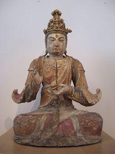 Guan Yin/Avalokiteshvara/Kannon... bodhisattva of compassion.