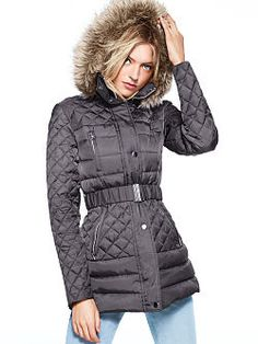 The perfect puffer: the Quilted Faux-fur Trim Puffer from Victoria's Secret. Quilted, down-filled and trimmed with plush faux-fur, this jacket is ultra-chic and ultra-versatile, to wear belted or relaxed, with the hood up or detached.