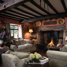 Patterned beige sofas in cottage living room with beamed ceiling and lighted fire in inglenook fireplace on Ambience Images from Arcaid Images, The architectural picture agency Cozy House, Rustic Cottage Interiors, Inglenook Fireplace, Inglenook, House Interior, English Decor, Cottage Living Rooms, Cottage Living, Rustic House