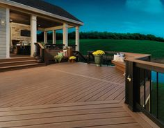 TimberTech Earthwood Evolutions Decking with Evolutions Rail in Builder Style in Classic Black. #TimberTech #Deck - timbertech.com