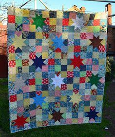 Another nine patch quilt with stars on it...gotta find this pattern to make one. I would make all the stars white and the nine patches would be color.
