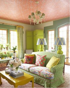 There is a lot going on in this room--patterns, colors, even on the ceiling, but it works in that way you never think it would until you see it done well.