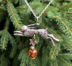 Silver Hare pendant, handmade by Hannah Willow #hare #amber #labyrinth #folklore #pagan #hannahwillow