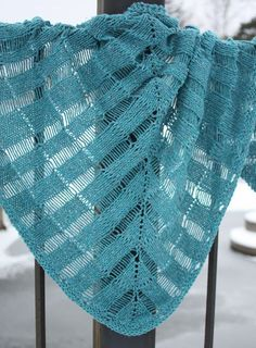 Free Knitting Pattern for Windlass Shawl - Windlass combines dropped stitches and easy elongated stitches in a top-down triangular shawl in a design by Amy Palmer.
